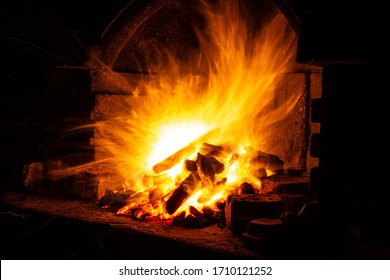 wood burning in the fireplace at night