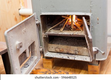 Wood burning inside the Solid bio fuel boiler. Renewable source of energy, green environmentally friendly fuel. Old warm cozy burning fire in a fireplace close up
