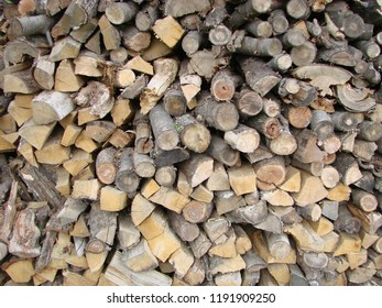 Wood burning stove. Firewood for furnace heating. Warehouse for firewood for stove.