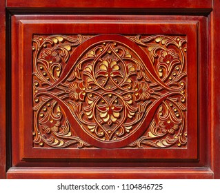 Wood carving in the form of a skilful floral pattern. Backgrounds