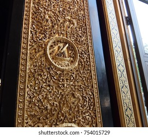 wood carving gold plated window of Thailand buddhist temple. Wat Bovorn Niwet Vihara in Bangkok Thailand.