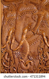 Wood carving pattern on the door of Thai temple.