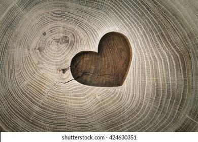 Wood carving, symbol of love, the heart. Background for your design