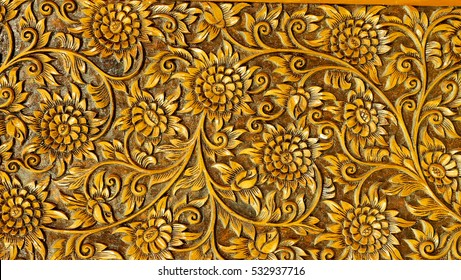 Wood carvings, floral Mean in Northern Thailand. Ancient motifs are used to decorate furniture that is made of teak.