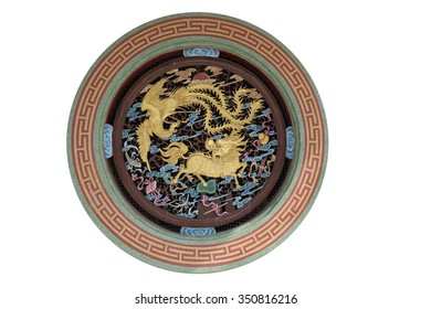Wood carvings, gold and peacock of Qilin on Valvoline Wall of China.