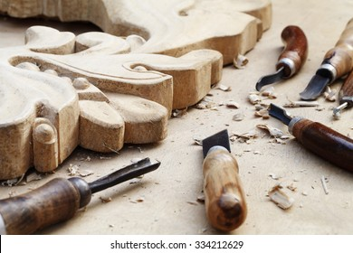 a wood carvings, tools and processes work closeup