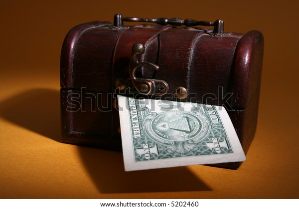 Wood cashbox isolated on brown