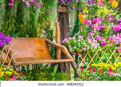 Wood chair in the flowers garden on summer./ Wood chair in the flowers garden.