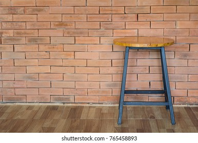 wood chair on brick wall background