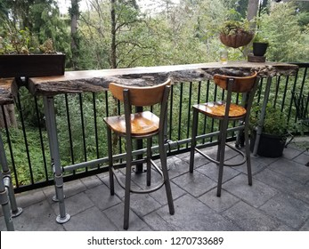 wood chairs or stools at wood table