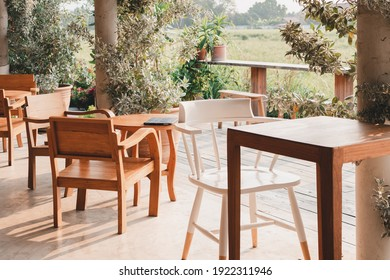 Wood chairs and wooden table in garden on green nature  background.