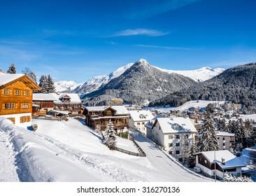 Wood chalet  over scenery of winter  resort Davos, Switzerland.