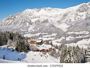 Wood chalet over snow mountains in Austrian Alpes.