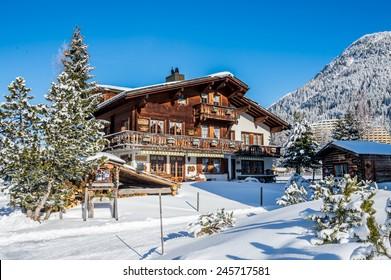 Wood chalet in winter resort Davos, Switzerland.