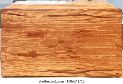 wood chest in contrasting rotten beech wood with dovetail connection