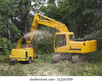 Wood chipper being fed by a