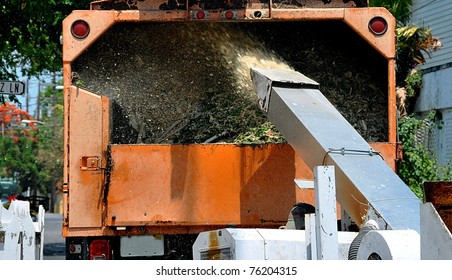 Wood Chipper Machine Filling Back Of Truck With Mulch