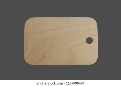 Wood chopping board. Close-up. Isolated on a gray background.