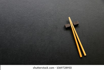 wood chopsticks on black table background