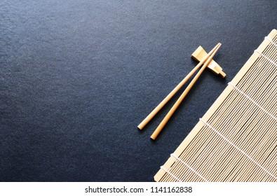 wood chopsticks on black table background,Copy space.