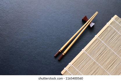 wood chopsticks on black table background