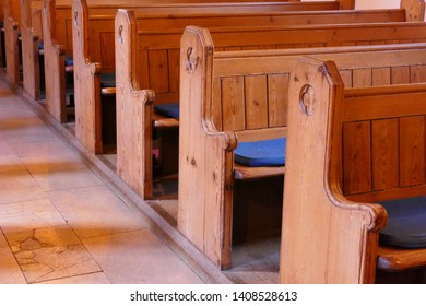Wood church pews symbol of faith loss and contemplation