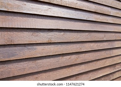 Wood cladding on an outside shed building with perspective lines