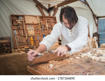 wood craftsman working in a mediterranean workshop; photographed during the medieval days, held in the city of Avila, Spain, during the month of September 2019