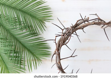 wood crown of thorns and palm leaves