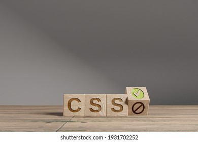 Wood cubes with acronym 'CSS' on a beautiful wooden table, studio background. Business concept with copy space.