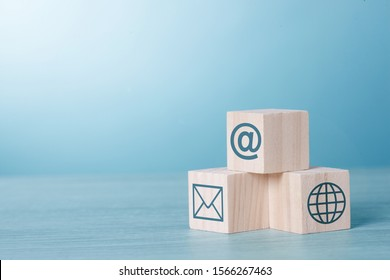Wood Cubic on table Blue Tone Background with Email Network At sign icon : Social Network and www Internet Concept.