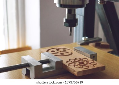wood cutting machine 3D wood cnc router. CNC milling machine carving a wooden part blank. Cutter controlled by computer while he is carving wood.
