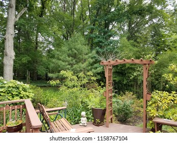 wood deck with bench and lattice and trees