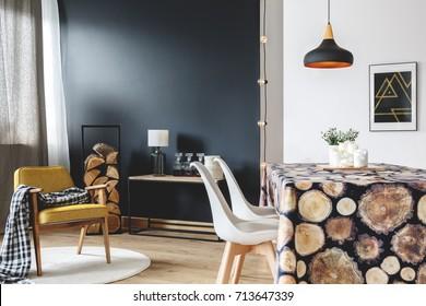 Wood design of modern interior with scandinavian furniture on black wall