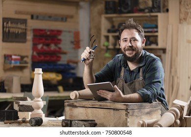 Wood designer working with tablet.