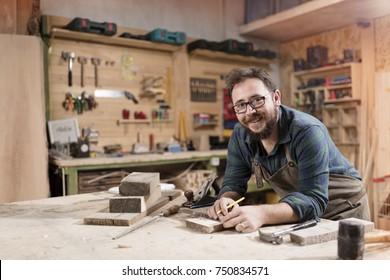 Wood designer working in workshop.