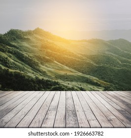 Wood desk or wood floor for product display with mountain view background