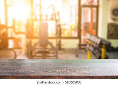 Wood desk and gym on background.