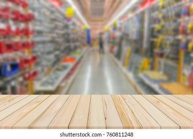 Wood desk or Wood plank with hardware shop blur background for product display
