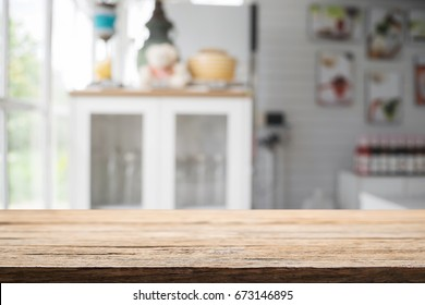 Wood desk space and blurred of kitchen background. for product display montage. business presentation.