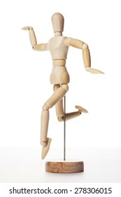 A wood doll dance, jump, indicate, run to somewhere with happy isolated white background in the studio.