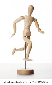A wood doll dance, jump, indicate, run to somewhere with happy like ballet isolated white background in the studio.