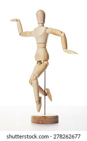 A wood doll make yoga, dance, jump, motion for health, diet isolated white background at the studio.
