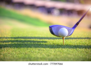 wood driver with golf ball on the tees off ready to impact hot away to the fairway ahead by the player