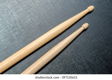 Wood Drumsticks isolated in black texture background