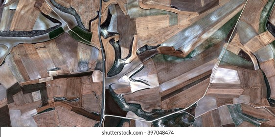 wood and earth, allegory, tribute to Picasso, abstract photography of the Spain fields from the air, aerial view, representation of human labor camps, abstract, cubism, abstract naturalism,