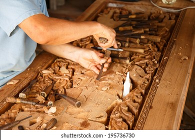 wood engraver at work for woodcut.