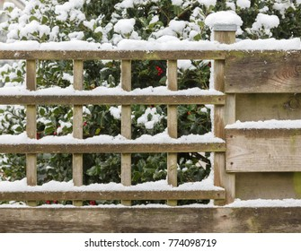Wood fence covered in snow - The Netherlands