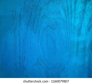 Wood fencing panel painted blue for use as a background