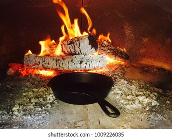 Wood fire oven cooking with cast iron pan